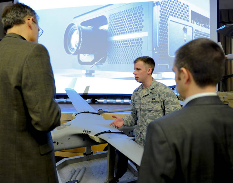 Capt. Lee M. Todd, an engineer at the Air Force Research Laboratory, briefs media during the release of the Small Unmanned Aircraft System Flight Plan at the Pentagon Conference Center May 17, 2016, in Washington, D.C. Integration of SUAS into operations across all domains and levels of warfare will increase the Air Force's ability to meet emerging requirements of combatant commanders. (U.S. Air Force photo by Tech. Sgt. Anthony Nelson Jr.)