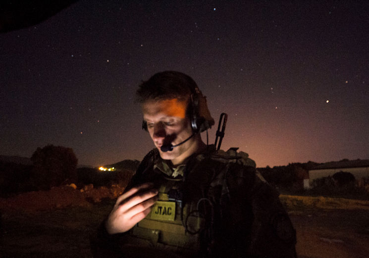 Senior Airman Tormod Lillekroken, 2nd Air Support Operations Squadron joint terminal attack controller, reviews training objectives as part of a night training scenario during Exercise Serpentex '16 in Corsica, France, March 15, 2016. Lillekroken recently reached his goal to be qualified as a joint terminal attack controller. Lillekroken has been in the tactical air control party career field for more than four years. (U.S. Air Force photo by Staff Sgt. Sara Keller)