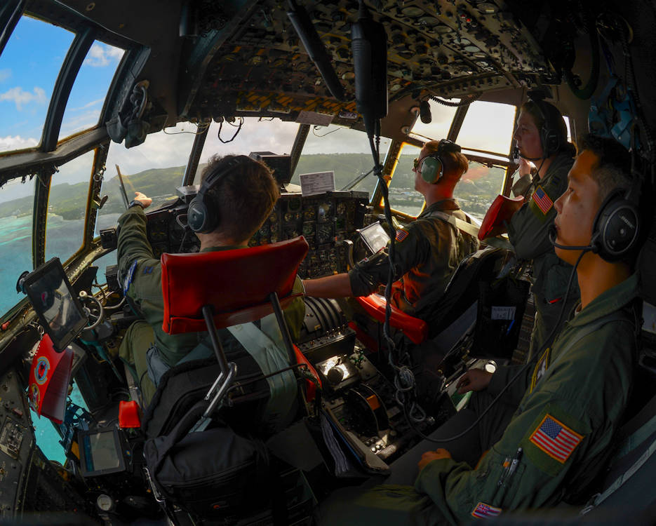 December 5, 2016 - Aircrew aboard a C-130 Hercules assigned to the U.S. Air Force 36th Airlift Squadron circle a Micronesian Island practicing airdrop procedures during Operation Christmas Drop. Each year Operation Christmas Drop provides aid to over 30,000 islanders in the Pacific. (U.S. Air Force photo by Senior Airman Elizabeth Baker)