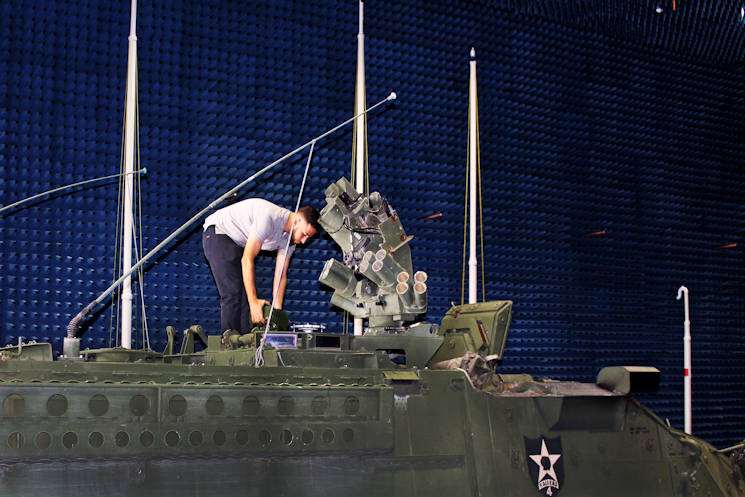 October 4, 2016 - Mohamed Khalil, CERDEC S&TCD, installs an anti-jam antenna onto a Stryker vehicle inside CERDEC's Anechoic Chamber. The chamber absorbs sound and electromagnetic waves and is used to test a variety of frequencies for large and mobile vehicle-mounted projects. (U.S. Army photo by Lindsey Rash, CERDEC CP&ID)