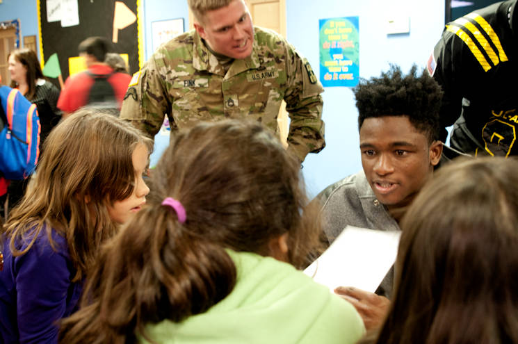 Team East defensive back Trayvon Mullen (right), Coconut Creek High School in Coconut Creek, Fla., and Sgt. 1st Class Andrew Fink, the 2016 Army Noncommissioned Officer of the Year, try to stump the students during a math game Tuesday, Jan. 5, 2016 at Boysville in San Antonio, Texas. Soldiers and the nation's top high school football players are visiting locations like Boysville, a program for children from abused and neglected homes, as part a way to give back to the community leading up to the 2016 Army All-American Bowl, heid Jan. 9, 2016 at the Alamo Bowl in downtown San Antonio. (U.S. Army photo by Sgt. Brandon Hubbard, 204th Public Affairs Detachment)