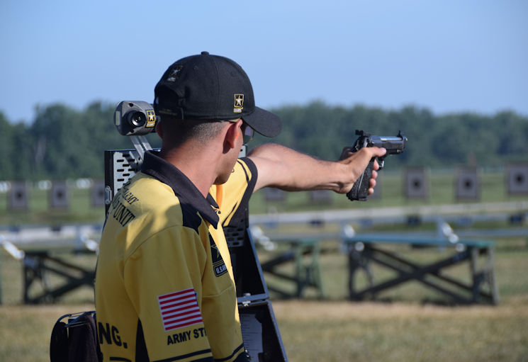 CAMP PERRY, Ohio (July 14, 2016) -- Spc. Anthony Heinauer, U.S. Army Marksmanship Unit (USAMU), aims downrange during the 2016 National Trophy Pistol Team Matches . His father, Sgt. Major Keith Heinauer, Fort Bragg, North Carolina, introduced him to the Matches about six years ago, and Anthony has competed the last three years. (Photo by Brenda Rolin, U.S. Army Marksmanship Unit)