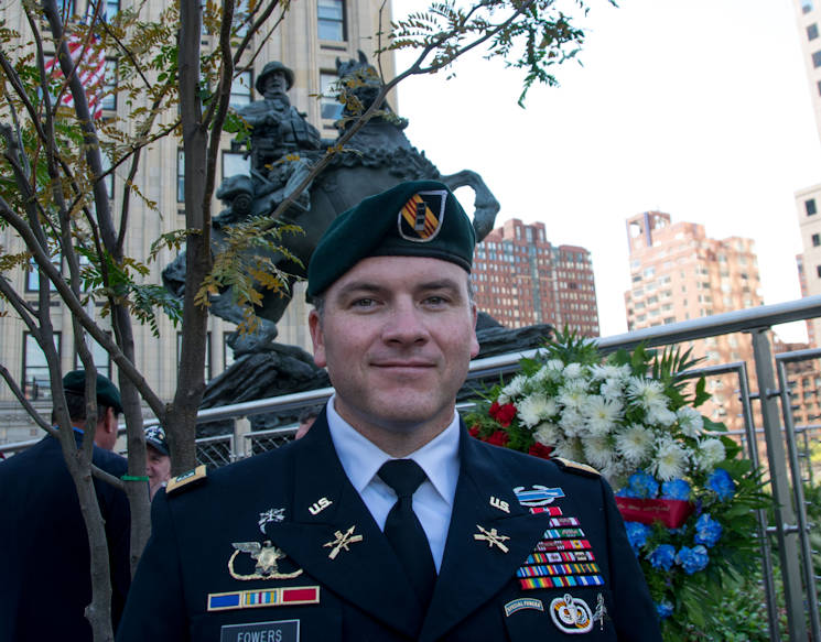November 11, 2016 - Chief Warrant Officer 2 Brad Fowers poses in front of De Oppresso Liber, or the Horse Soldier, a 16-foot bronze statue honoring the work of Special Forces Soldiers in Afghanistan at the beginning of Operation Enduring Freedom in the last months of 2001. Recently rededicated, the statue stands near ground zero in New York. Fowers served as a junior weapons sergeant on Operational Detachment A 572 in 2001. (Photo by Cheryle Rivas, U.S. Army Special Operations Command)