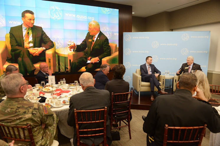 Secretary of the Army Eric K. Fanning (left), speaks at an Association of the United States Army's Institute of Land Warfare-hosted professional development forum breakfast, June 28, 2016 in Arlington, Va. Retired Gen. Carter Ham (right) moderates the discussion. (U.S. Army photo by David Vergun)