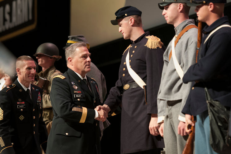 October 3, 2016 - Army Chief of Staff Gen. Mark A. Milley and Sgt.Maj. of the Army Daniel A. Dailey shake hands with Soldiers dressed in uniforms of previous conflicts during the opening ceremony of the Association of the U.S. Army Annual Meeting and Exposition in Washington, D.C. (Photo by Sean Kimmons, Air Force News Service)