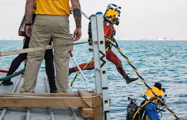 November 18, 2016 - U.S. Army engineer divers with the 511th Engineer Dive Detachment from Fort Eustis, VA jump off the MG Charles P. Gross (Logistics Support Vessel-5) and into the Arabian Gulf, off the coast of Kuwait Naval Base, to practice diving procedures. The unit executed various diving techniques and certified diving supervisors in emergency protocol throughout the exercise, Operation Deep Blue, enhancing the team's overall readiness and ability to support U.S. Army Central missions. (U.S. Army photo by Sgt. Angela Lorden)