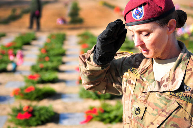 December 17, 2016 - Sgt. 1st. Class Jean Mott, a XVIII Airborne Corps Soldier, salutes a fallen Soldier's grave during a Wreaths Across America event at the Sand Hills State Veteran's Cemetery in Spring Lake, NC. Wreaths Across America, an annual-event that began in Maine in 1992, is conducted as a way to honor fallen service members.(U.S. Army photo by Pfc. Hubert D. Delany III)