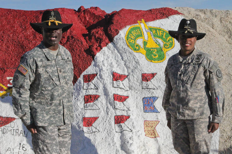 "Lt. Col. Lynn Ray (right), the first commander of Regimental Engineer Squadron ""Pioneer,"" 3rd Cavalry Regiment, poses with Command Sgt. Maj. Rodney Holloway, senior enlisted advisor, at Painted Rock at Fort Irwin, California after 3rd CR's National Training Center rotation February 27, 2016. (U.S. Army photo by Staff Sgt. Tomora Clar)"