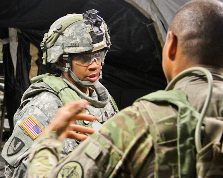 "During the 3rd Cavalry Regiment's National Training Center rotation, Lt. Col. Lynn Ray, the first commander of Regimental Engineer Squadron ""Pioneer,"" 3rd CR, talks to a Soldier about tactical movements February 14, 2016 at Fort Irwin, California. (U.S. Army photo by Staff Sgt. Tomora Clar)"