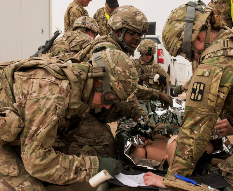 Soldiers from 1st Battalion, 63rd Armor Regiment, and the 10th Combat Support Hospital, treat simulated patients at a tactical combat casualty care lane at Camp Buehring, Kuwait, February 23, 2016. The 40th Combat Aviation Brigade ran a two-day TCCC course for medics stationed at the camp. (U.S. Army photo by Staff Sgt. Ian M. Kummer, 40th Combat Aviation Brigade Public Affairs)