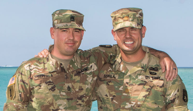 July 26, 2016 - U.S. Army Maj. Joel Seppala (right), a future operations planner, and Sgt. 1st Class Timothy Seppala (left), the senior religious affairs noncommissioned officer-in-charge with the 94th Army Air and Missile Defense Command, pose together for a photo near the beach at Joint Base Pearl Harbor-Hickam, Hawaii. (U.S. Army photo by Sgt. Kimberly Menzies, 94th Army Air and Missile Defense Command Public Affairs)