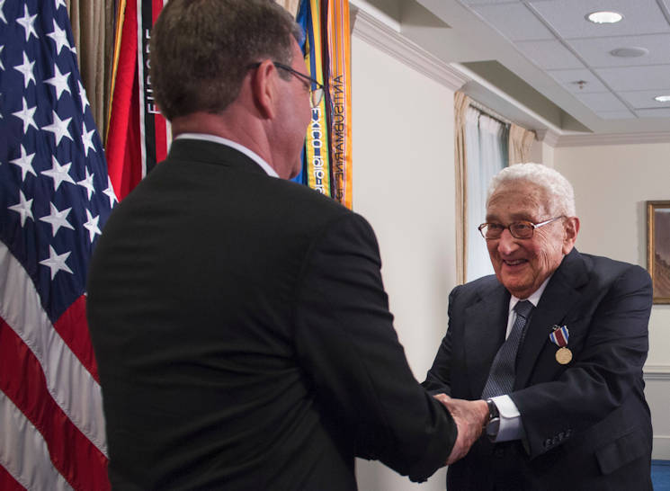 May 9, 2016 - Defense Secretary Ash Carter shakes former Secretary of State Henry A. Kissinger's hand during an award ceremony at the Pentagon honoring Kissinger for his years of distinguished public service, . Kissinger received the Department of Defense Distinguished Public Service Award. (DoD photo by Air Force Senior Master Sgt. Adrian Cadiz)