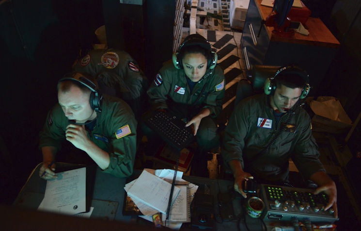 Crew members aboard an HC-130 Hercules airplane from Air Station Barbers Point monitor surveillance equipment for suspected of drug trafficking in the Eastern Pacific, Jan. 25, 2016. Military patrol aircraft search for drug traffickers around the clock in an attempt to reduce illegal drug activity in the region. (U.S. Coast Guard photo by Petty Officer 2nd Class Melissa E. McKenzie)