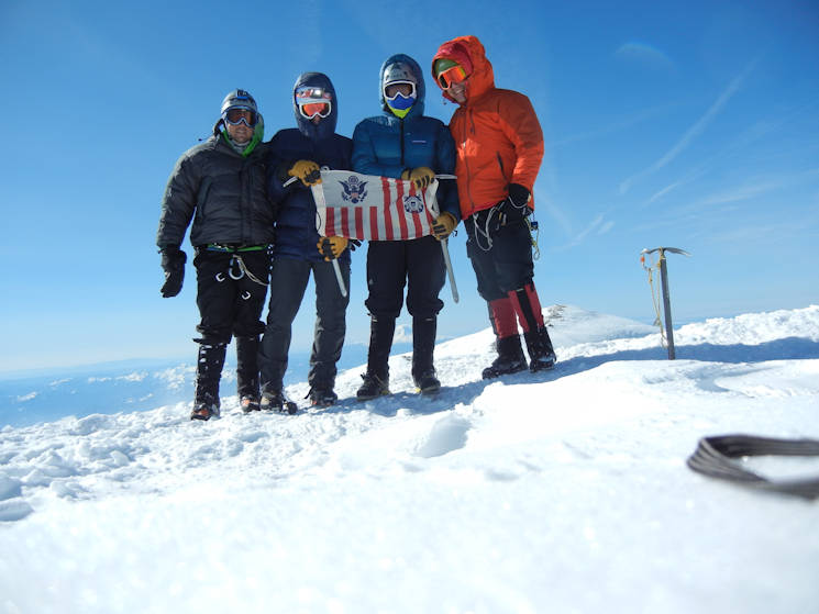 May 17, 2016 - Petty Officer 2nd Class Nick DeBrum, Petty Officer 2nd Class Ryan Griffin, Petty Officer 2nd Class Scott Wingfield and Petty Officer 3rd class Adam Plourde, from Coast Guard Sector Puget Sound in Seattle, display the Coast Guard ensign at the summit of Mount Rainier. At 14,410 feet above sea level, Mount Rainier is Washington's tallest mountain. (U.S. Coast Guard photo by Petty Officer 2nd Class Nick DeBrum)