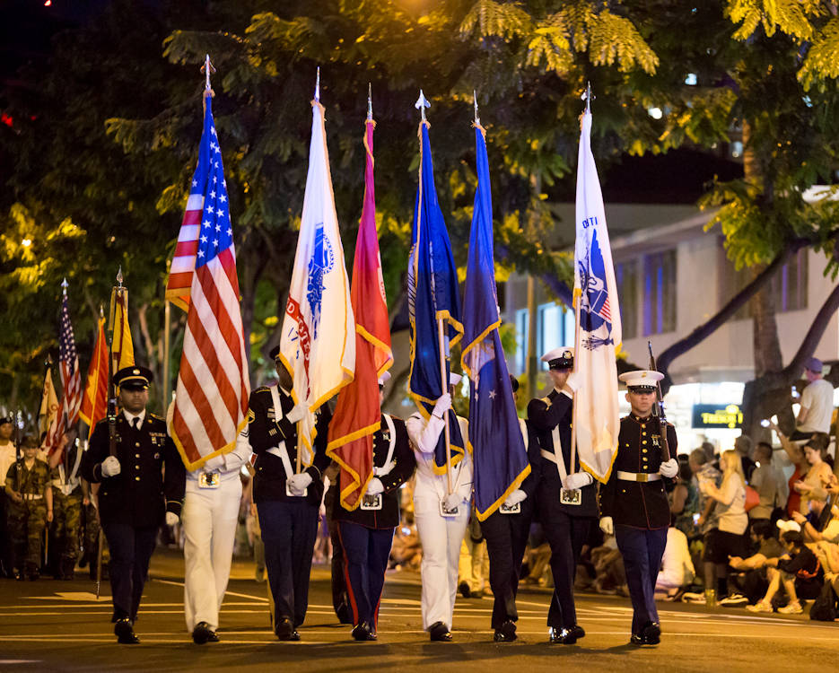 December 7, 2016 - The U.S. Pacific Command joint service color guard marches down Kalakaua Avenue during the Pearl Harbor Memorial Parade at Fort Derussy Beach Park, Hawaii. Civilians, veterans, and service members came together to remember and pay their respects to those who fought and lost their lives during the attack on Pearl Harbor. (U.S. Marine Corps photo by Lance Cpl. Robert Sweet)