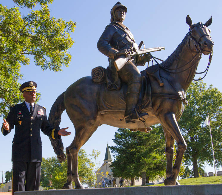 Sept. 19, 2016 - Brig. Gen. Kevin Vereen, chief of the Military Police Corps Regiment, speaks at the dedication of a Dragoon statue at the Military Police Regimental Grove at Fort Leonard Wood, Missouri. MPs attended events throughout the week to mark the regiment's 75th anniversary. (U.S. Army photo by Sgt. 1st Class Jacob Boyer)