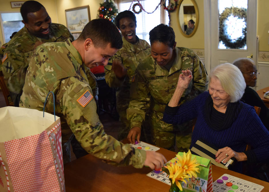 December 20, 2016 - Georgia Guardsmen laugh with residents of the Azalea Manor Assisted Living Facility during a holiday visit. Twenty Georgia Guardsmen visited the residents and provided gifts and holiday cheer. (Georgia National Guard photo by U.S. Army Capt. William Carraway)