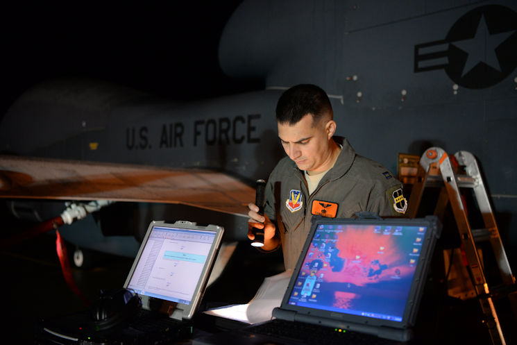"November 1, 2016 - Capt. Thomas, 12th Reconnaissance Squadron RQ-4 Global Hawk pilot, reviews a pre-flight checklist at Beale Air Force Base, California. Thomas fulfilled the role of ""Hawkeye"". Hawkeye is the call sign for the designated RQ-4 Pilot who performs pre-flight inspections for RQ-4 Global Hawks prior to flight. (U.S. Air Force photo by Staff Sgt. Bobby Cummings)"
