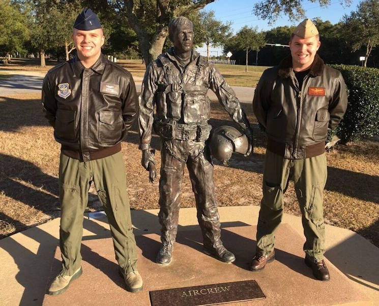 ustin Medlen (Air force) and Jeremy Medlen (Navy), stand proudly next to a pilot statue on February 13, 2016 in Pensacola, Fla. Jeremy had just graduated from pilot training and received his pilot wings the day before. Jeremy's twin brother Justin is also a pilot for the Navy. (Photo by U.S. Air Force Airman 1st Class Taylor Bourgeous)