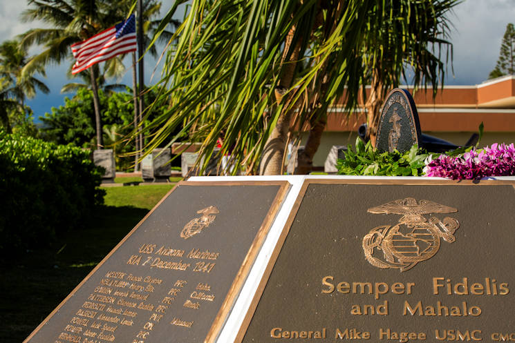 A U.S. flag at half-mast billows in the wind during the Marine Memorial Rededication Ceremony at the USS ARIZONA Education Center, Honolulu, Hawaii, Aug. 19, 2016. Three plaques on the memorial are dedicated to the 73 U.S. Marines that made the ultimate sacrifice during the attack on Pearl Harbor. (Marine Corps photo by Lance Cpl. Robert Sweet)