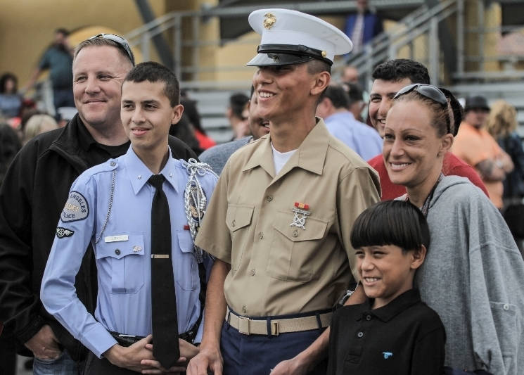 Pvt. Raphael Martinez Bobek, a Marine with 2nd Battalion, Hotel Company, Platoon 2173, with family and friends aboard Marine Corps Recruit Depot, San Diego, California after graduating from recruit training April 8, 2016. (U.S. Marine Corps photo by Cpl. Mark Adams)