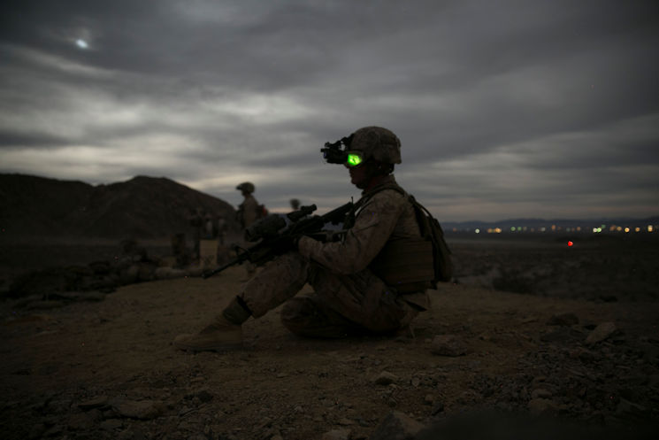 November 16, 2016 - Cpl. Ryan Weston, squad leader, 1st Battalion, 7th Marine Regiment, looks down Range 400 aboard Marine Corps Air Ground Combat Center, Twentynine Palms, Calif., during the unit's night-time combined arms live-fire exercise. (U.S. Marine Corps photo by Cpl. Julio McGraw)