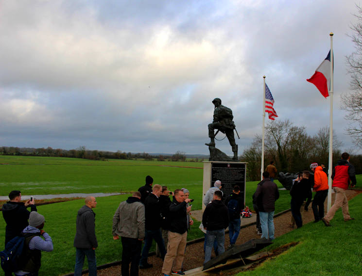 U.S. Marine noncommissioned officers of U.S. Marine Corps Forces Europe and Africa at the Iron Mike statue in Normandy, France, Dec. 11-13, 2015 for a battle-field study of the historic amphibious Allied landings during World War II, also known as D-Day. The Marine NCOs are the backbone of service component operations for U.S. European Command that supports numerous NATO-led operations and exercises in Europe that enables the Alliance to continue their proven, enduring partnerships. (U.S. Marine Corps courtesy photo)