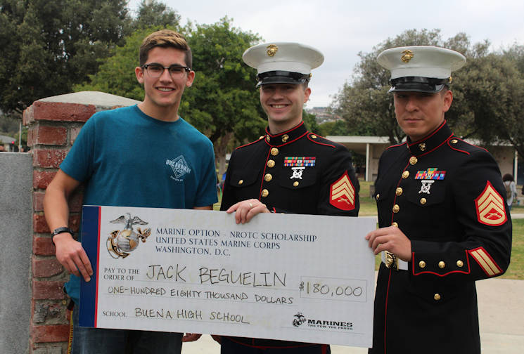 Sergeant Weldon Housley, center, and Staff Sergeant Edwin Salvatierra, right, present a Naval Reserve Officers Training Corps scholarship check to Jack Beguelin at Buena High School in Ventura, Calif., Jan. 15, 2016. The NROTC scholarship, valued at up to $180,000, will pay for the cost of full tuition, books and other educational fees at many of the country's leading colleges and universities. (U.S. Marine Corps photo by Staff Sgt. Alicia R. Leaders)