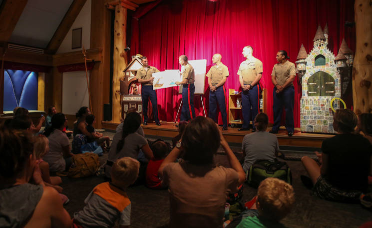 September 7, 2016 - Marines with Marine Light Attack Helicopter Squadron 167 based out of New River, NC read a book to children at the Nashville Public Library in Nashville, Tenn. Marine Week Nashville is an opportunity for the people of the greater Nashville area to meet Marines and learn about Corps' history, traditions and value to the nation. (U.S. Marine Corps photo by Sgt. Lucas Hopkins)