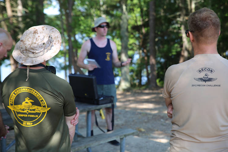 July 18, 2016 - Navy Diver First Class Jason Young (center), Marine Corps Systems Command diving officer with Reconnaissance and Amphibious Raids, gives a safety briefing prior to a dive at Lake Anna in Spotsylvania, Va. The RAR team worked with several Marine combatant divers to conduct tests of potential upgrades to the Diver Propulsion Device to improve its speed and controllability. (U.S. Marine Corps photo by Monique Randolph)