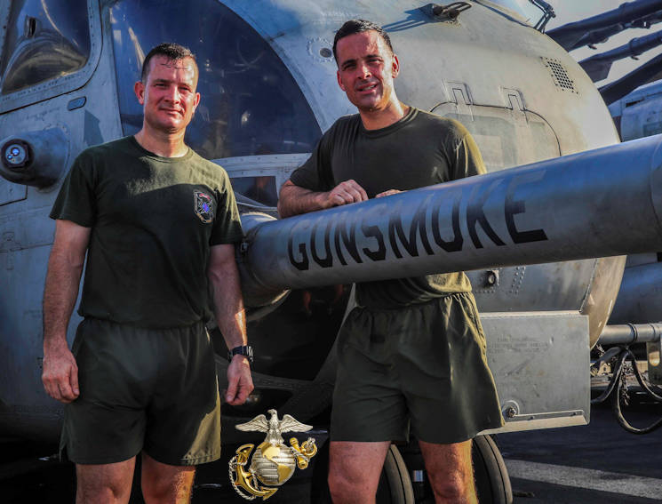 May 13, 2016 - U.S. Marines Lt. Col. Jonathan R. Smith (left), the ground combat element commander with the 13th Marine Expeditionary Unit, and Maj. Michael F. Smith, air combat element operations officer with the 13th MEU, stand side-by-side next to the CH-53E detachment flagship, 'Gunsmoke' helicopter, fuel probe aboard the USS Boxer (LHD 4). The flagship is named after the 13th MEU's Battalion Landing Team, which is commanded by Jonathan, and piloted by Michael. (Image created by USA Patriotism! from U.S. Marine Corps photo by Cpl. Alvin Pujols)