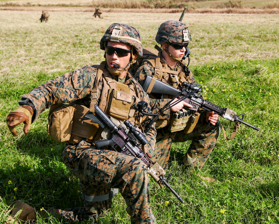 1st Lt. Patrick Nugent, a platoon commander with Charlie Company, Battalion Landing Team 1st Battalion, 5th Marines, 31st Marine Expeditionary Unit, directs his Marines into their positions during an assault on the airfield at the Ie Shima Training Facility, Okinawa, Japan, Feb. 12, 2016. Marines and sailors with the 31st MEU flew from the USS Bonhomme Richard (LHD 6) to Ie Shima for a vertical assault as part of amphibious integration training with the Navy ships of the Bonhomme Richard Amphibious Ready Group. The 31st MEU is currently deployed to the Asia-Pacific region. Nugent is a Cleveland native. (U.S. Marine Corps photo by Gunnery Sgt. Zachary Dyer)