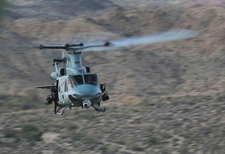A UH-1Y Huey with Marine Aircraft Group 39 conducts close-air support during a MAGTF Integration Exercise in El Centro, Calif., April 28, 2016. As part of Marine Aircraft Group 39's new integration effort, they conduct integration exercises quarterly that closely integrate ground and air assets allowing for a greater degree of symbiotic training. (U.S. Marine Corps photo by Cpl. Alissa Schuning)