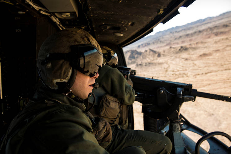 "February 5, 2016 - Sgt. Benjamin Hebert, a crew chief with Marine Light Attack Helicopter Squadron 469 (HMLA-469), based out of Marine Corps Air Station Camp Pendleton, Calif., observes and verifies hits as Sgt. Daniel O'Niel, an aerial observer, fires a GAU-21 machine gun from a UH-1Y ""Venom,"" during exercise ""Scorpion Fire,"" at the Chocolate Mountain Aerial Gunnery Range, Friday. (U.S. Marine Corps photo by Pfc. George Melendez)"