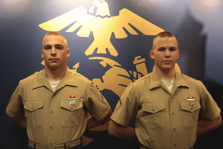 pringville, N.Y., natives Marine Corps Pfc. Brandon Willibey, left, an aviation ordnance technician student, and his brother, Marine Corps Pfc. Justin Willibey, a military policeman student, graduated from recruit training at Marine Corps Recruit Depot Parris Island, SC on September 18, 2015. Their boot camp photos are displayed in the Marine Corps recruiting substation in West Seneca, NY. (U.S. Marine Corps photo by Sgt. Christopher O'Quin)