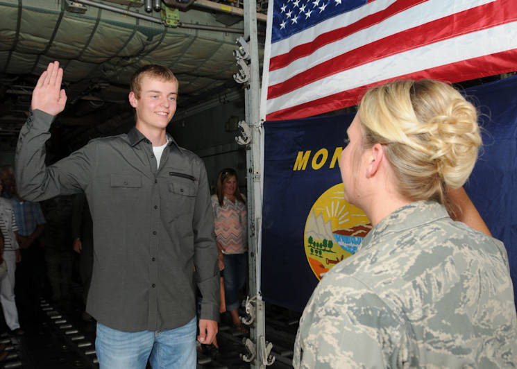 August 31, 2016 - Tyler LaPierre recites the oath of enlistment during his Montana Air National Guard enlistment ceremony in the cargo hold of a C-130 Hercules transport aircraft parked at the 120th Airlift Wing in Great Falls, Montana. His aunt, Capt. Jennifer LaPierre Gunter, administered the oath. (U.S. Air National Guard photo by Senior Master Sgt. Eric Peterson)