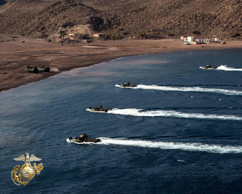 December 6, 2016 - Amphibious assault vehicles with the 11th Marine Expeditionary Unit prepare to land during the initial landing phases of Exercise Alligator Dagger. The exercise involves all three ships of the Makin Island Amphibious Ready Group and enables the Marines and sailors of the 11th MEU to conduct the comprehensive amphibious operations that keep their skills ready for crisis response and contingency operations throughout the Central Command area of responsibility. (Image created by USA Patriotism! from U.S. Marine Corps photo by Lance Cpl. Devan Gowans)