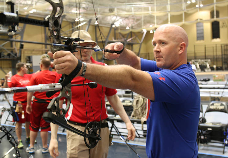 U.S. Marine Corps logistics officer, Maj. Lee Stuckey, practices his archery skills in preparation for competition at the 2016 DoD Warrior Games at the United States Military Academy, West Point, N.Y., June 13, 2016. Stuckey, who is recovering from a shoulder injury, had to adapt to his respective sport by making adjustments to his compound bow. (U.S. Army photo by Sgt. Brandon L. Rizzo)