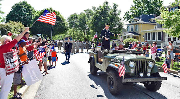 Army Reserve Brig. Gen. Frederick R. Maiocco Jr., Commanding General, 85th Support Command, waves from a World War II era jeep during the Memorial Day Parade in Arlington Heights, Illinois on May 30, 2016. (US Army Photo by Sgt. Aaron Berogan)