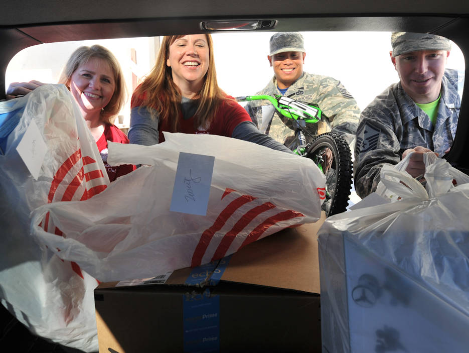 December 16, 2016 - The Tyndall Spouses Club and First Sergeants Group load donated children's gifts during Operation Angel Tree at the base Thrift Shop on Tyndall Air Force Base, Florida. Operation Angel Tree provided gifts to 225 children from 128 Tyndall families. (U.S. Air Force photo by Senior Airman Ty-Rico Lea)
