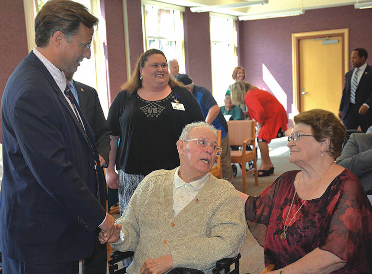 September 16, 2016 - Virginia Congressman Dave Brat shakes hands with retired Sgt. 1st Class Pablo Rivera as his wife, Paula, looks on during the legistator's presentation of the Congressional Gold Medal at the Sitter and Barfoot Veterans Care Center in Richmond. (Courtesy photo by U.S. Army Garrison Fort Lee)
