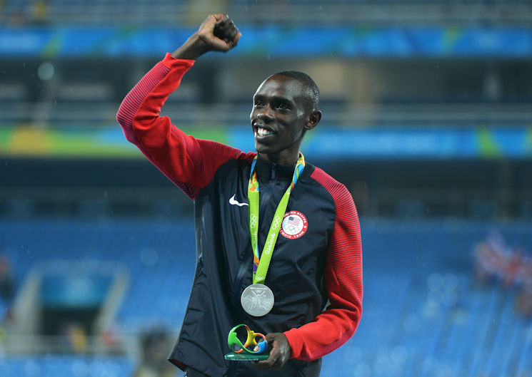 Spc. Paul Chelimo of the U.S. Army World Class Athlete Program finishes runner-up to Mo Farah of Great Britain to claim the silver medal in the men's 5,000-meter run with a personal-best time of 13 minutes, 3.90 seconds Aug. 20, 2016 at the 2016 Olympic Games in Rio de Janeiro, Brazil. Farah won the gold in 13:03.30 and Hagos Gebrhiwet of Ethiopia took the bronze in 13:04.35. Chelimo was disqualified from the race but later reinstated and collected his silver medal at the awards ceremony, which was delayed to sort it out.(U.S. Army photo by Tim Hipps, Installation Management Command)