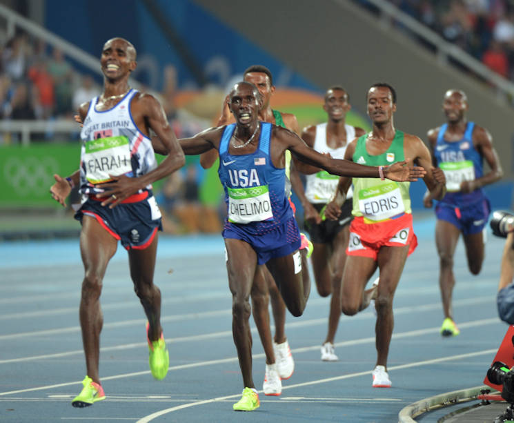 Spc. Paul Chelimo (center) of the U.S. Army World Class Athlete Program finishes runner-up to Mo Farah of Great Britain to claim the silver medal in the men's 5,000-meter run with a personal-best time of 13 minutes, 3.90 seconds Aug. 20, 2016 at the Rio Olympic Games in Rio de Janeiro, Brazil. Farah won the gold in 13:03.30 and Hagos Gebrhiwet of Ethiopia took the bronze in 13:04.35. Chelimo was disqualified from the race but he was later reinstated and collected his silver medal at the awards ceremony.(U.S. Army photo by Tim Hipps, Installation Management Command)