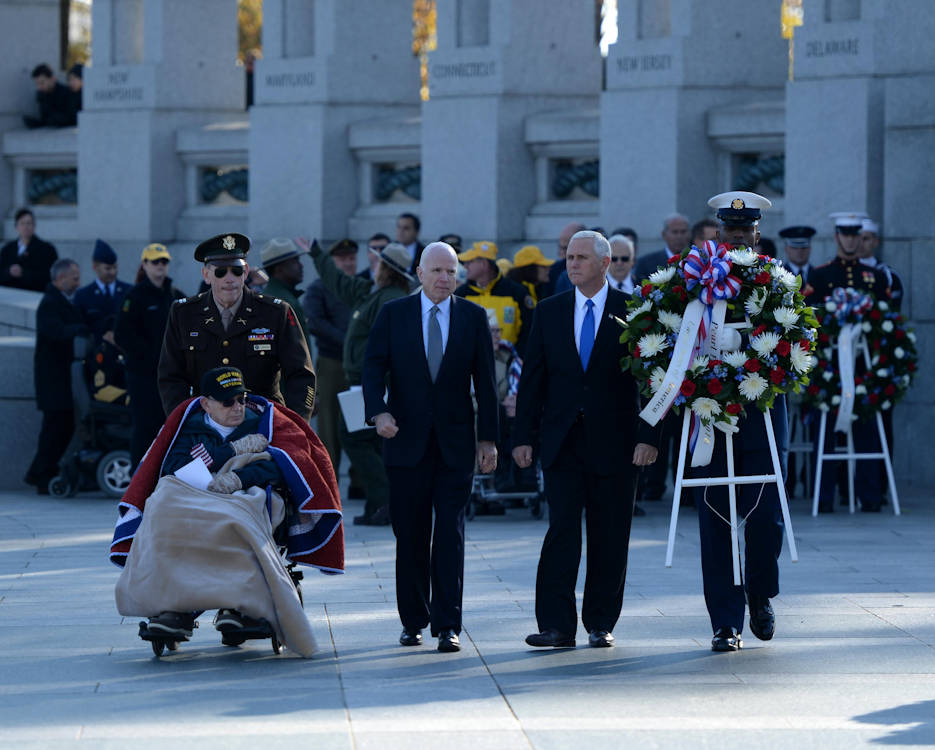 December 7, 2016 - World War II veteran William Flatters, U.S. Sen. John McCain and Vice President-elect Mike Pence walk toward the location they will be laying a wreath during the 2016 Pearl Harbor Remembrance Day 75th Anniversary Commemoration at the World War II Memorial in Washington, D.C. (U.S. Army photo by Sgt. Jose A. Torres Jr.)
