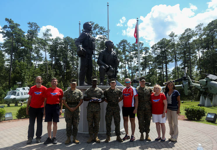 September 1, 2016 - Retired Air Force Col. Gary West stands with Marines and teammates after a flag folding ceremony on Marine Corps Air Station New River West is riding 2,500 miles to raise awareness of the sacrifices of fallen service members and their families.  (U.S. Marine Corps photo by Sgt. Jared Lingafelt)