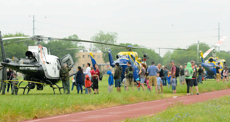 Members of the community speak with local first responders and check out rescue helicopters during the 10th annual Texas Military Department's Open House featuring the American Heroes Air Show at Camp Mabry in Austin, Texas, April 16, 2016. The event showcases the Texas Military Department and various state and local law enforcement agencies, first responders, volunteer services and veteran support organizations. The free two day event featured the Traveling Vietnam Wall, a naturalization ceremony for members of all military branches, World War II and Vietnam reenactments, the Missing in America Project, local first responder demonstrations, a JROTC Drill competition and numerous vendors. (U.S. Army National Guard photo by Spc. Christina Clardy)