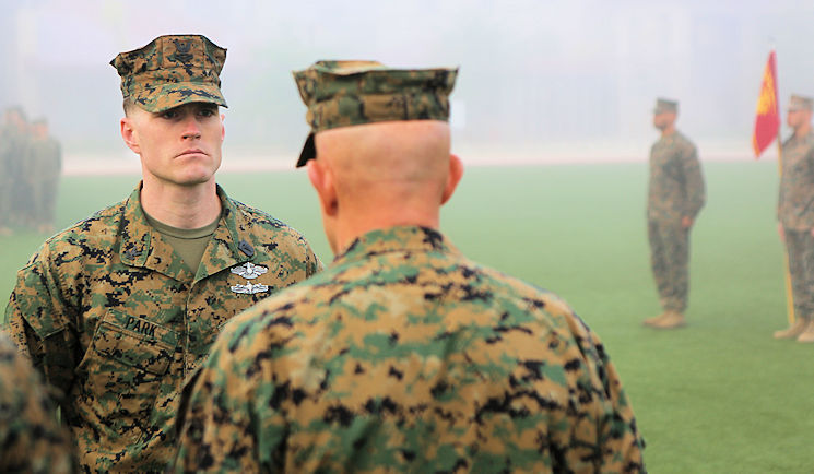 Navy Hospital Corpsman Petty Officer 2nd Class Robert Park, a combat trauma management instructor with the 1st Marine Division Surgeon's Office, stands at attention during an award ceremony aboard Camp Pendleton, Calif., Feb. 29, 2016. Park was selected as I Marine Expeditionary Force's Junior Sailor of the Year, and was awarded the Navy and Marine Corps Commendation Medal by Lt. Gen. David Berger, commanding general of I MEF. (U.S. Marine Corps photo by Staff Sgt. Justin Kronenberg)