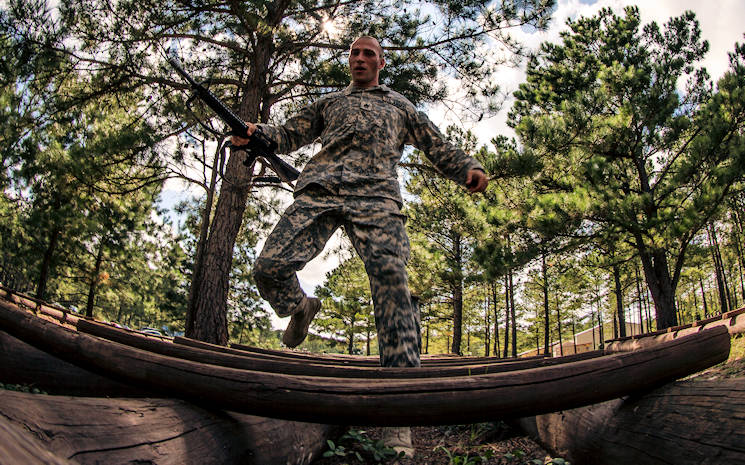 Army Reserve Drill Sergeant of the Year contestant, Staff Sgt. Russell Vidler, 98th Training Division (IET), the log obstacle on the Fit to Win course during the third day of the four-day TRADOC Drill Sergeant of the Year competition held at Fort Jackson, S.C., Sept. 7-10, 2015. Vidler is in a head-to-head competition with Staff Sgt. Mark Mercer, 95th Training Division (IET), for the title of Army Reserve's top drill sergeant. (U.S. Army photo by Sgt. 1st Class Brian Hamilton)