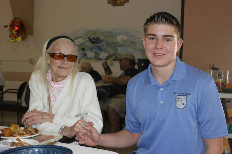 November 27, 2014 - Ryan Pavey (15) holds the hand of Lola Oliver while visiting the Veteran's Home of California in Younville, Calif. (Courtesy photo)
