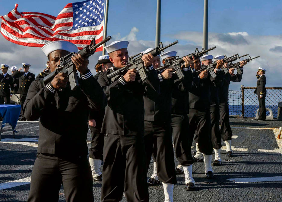 November 26, 2016 - Sailors fire the first of three volleys to honor the deceased during a burial at sea ceremony aboard the Arleigh Burke-class guided-missile destroyer USS Mahan (DDG 72). The ship is in the U.S. 6th fleet area of operations in support of U.S. national security interests in Europe. (U.S. Navy photo by Petty Officer 1st Class Tim Comerford)